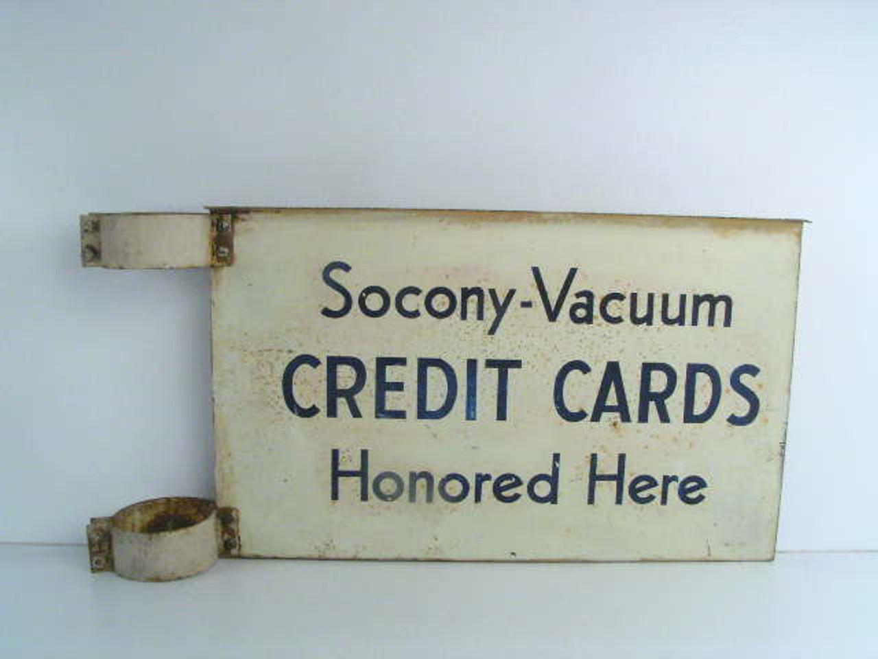 This rare pole mount two sided antique gas station sign advertises Socony  Vacuum credit cards honored here and may of attached to a gas pump island