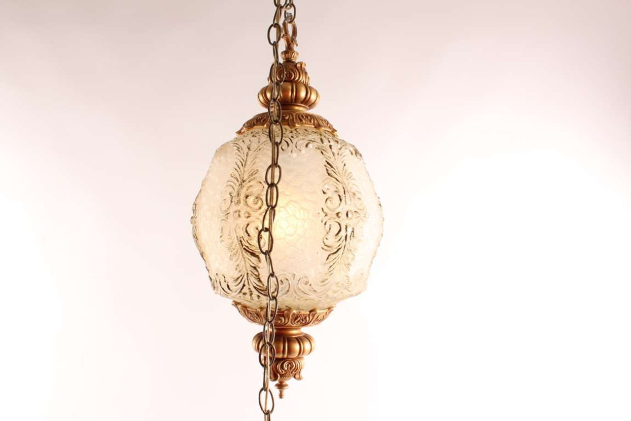 Vintage swag lamp with molded glass globe chain