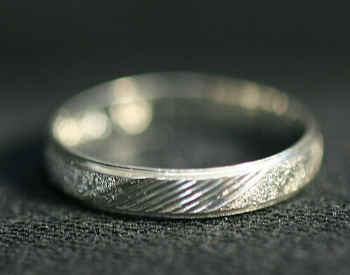 Pre-Owned Men's Sterling Silver Etched Wedding Band Sz. 9