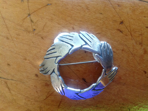 Sterling silver pin round united hands
