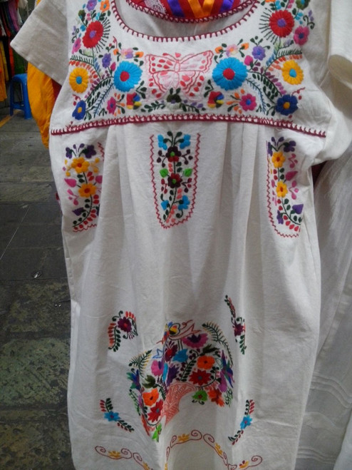 Beautiful dress with hand stitched flower design in bright colors!