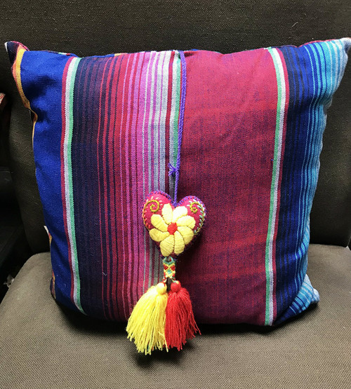Purple striped pillow with tassel attached
