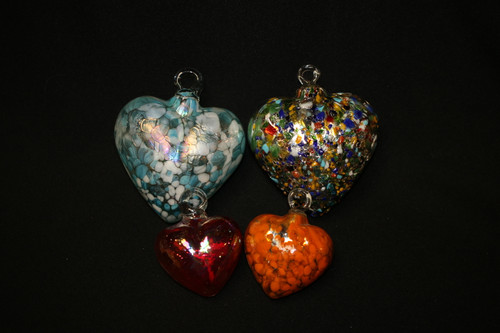 Hand blown glass hearts pictured in small and medium.
