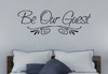 Be Our Guest Wall Decal Sticker shown in Black on gray wall