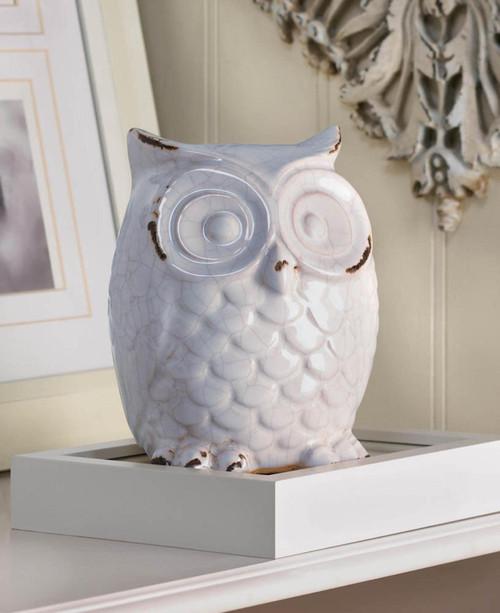 Distressed white owl figurine