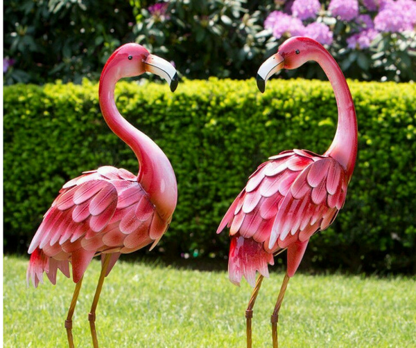 bright standing flamingo stataues