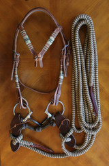"""B & H Snaffle Bridle shown with our Futurity Knot Rawhide Accented Headstall and brown Two Piece Slobber straps, with optional Mecate Rein, in our brown/tan zig zag pattern, and a solid brown chin strap. Bit shown is a SS 5"""" D-Ring Snaffle with a Sweet Iron Mouth Piece."""