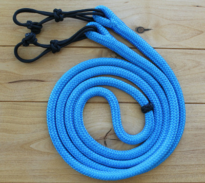 9ft. Cowboy Rope Reins in Pacific Blue with Black Rein Connectors. Rein Connectors and a fancy Turks Knot at the center of the reins for hand placement included.