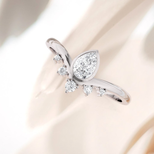 Diamond ring. Engagement ring. Pear shape modern designer engagement ring. Available in Platinum and 14K or 18K.