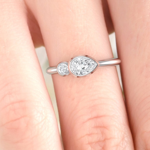 Diamond ring design. Engagement ring. Pear shape modern designer engagement ring. Available in Platinum and 14K or 18K.