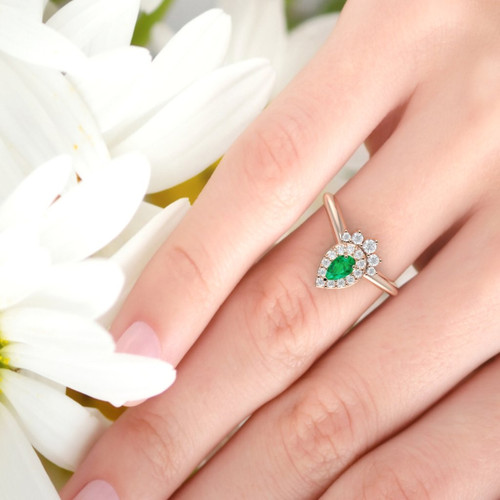 emerald ring on a finger