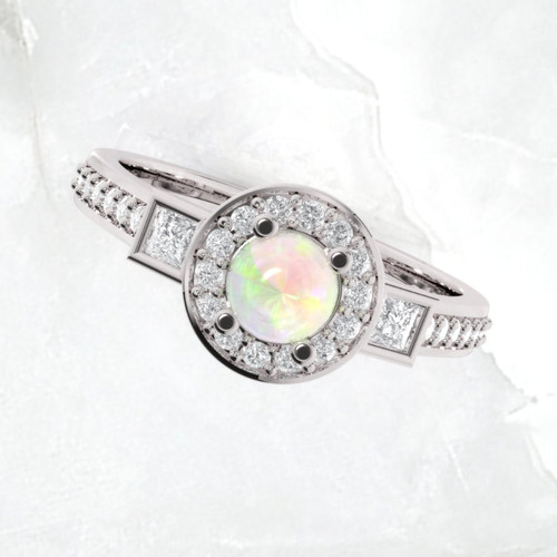 Opal engagement ring. Engagement ring. Diamond and opal ring. Available in 14K, 18K yellow, white and rose gold also in platinum.