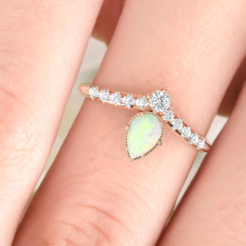 Opal ring. Opal and diamond ring. Opal engagement ring. Gemstone ring. Pear shape opal and pave set diamonds.