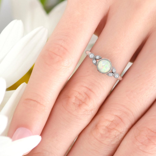 Opal ring. Opal and diamond ring. Opal engagement ring with fine millgrain detail. 14K, 18K or platinum.