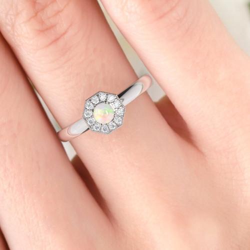 opal ring on finger