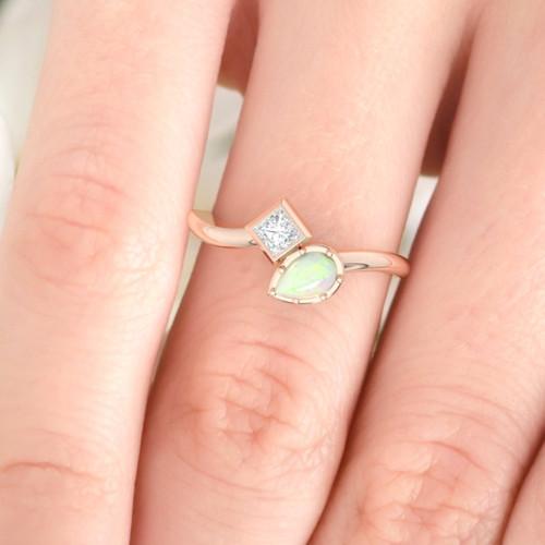 model displays opal ring