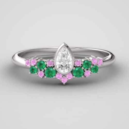 Pink sapphire, emerald and pear cut diamond ring.