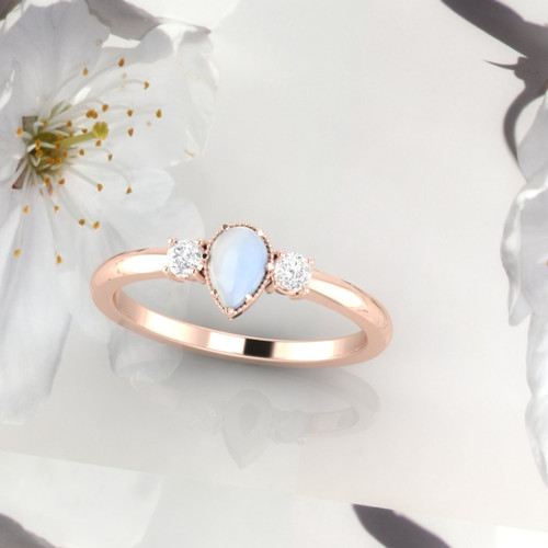 Moonstone ring. Moonstone and diamond ring. Moonstone engagement ring. Pearshape moonstone ring. 14K, 18K or platinum.