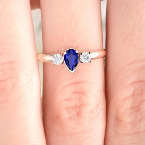 Sapphire and diamond engagement ring. Diamond ring. Pear shape sapphire.
