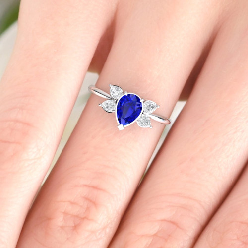 Engagement ring. Pear shape sapphire and diamond ring.