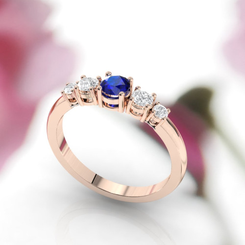 side view of rose gold diamond and sapphire ring