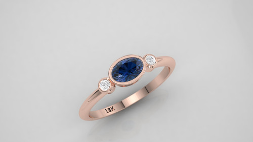 Oval sapphire and diamond ring.