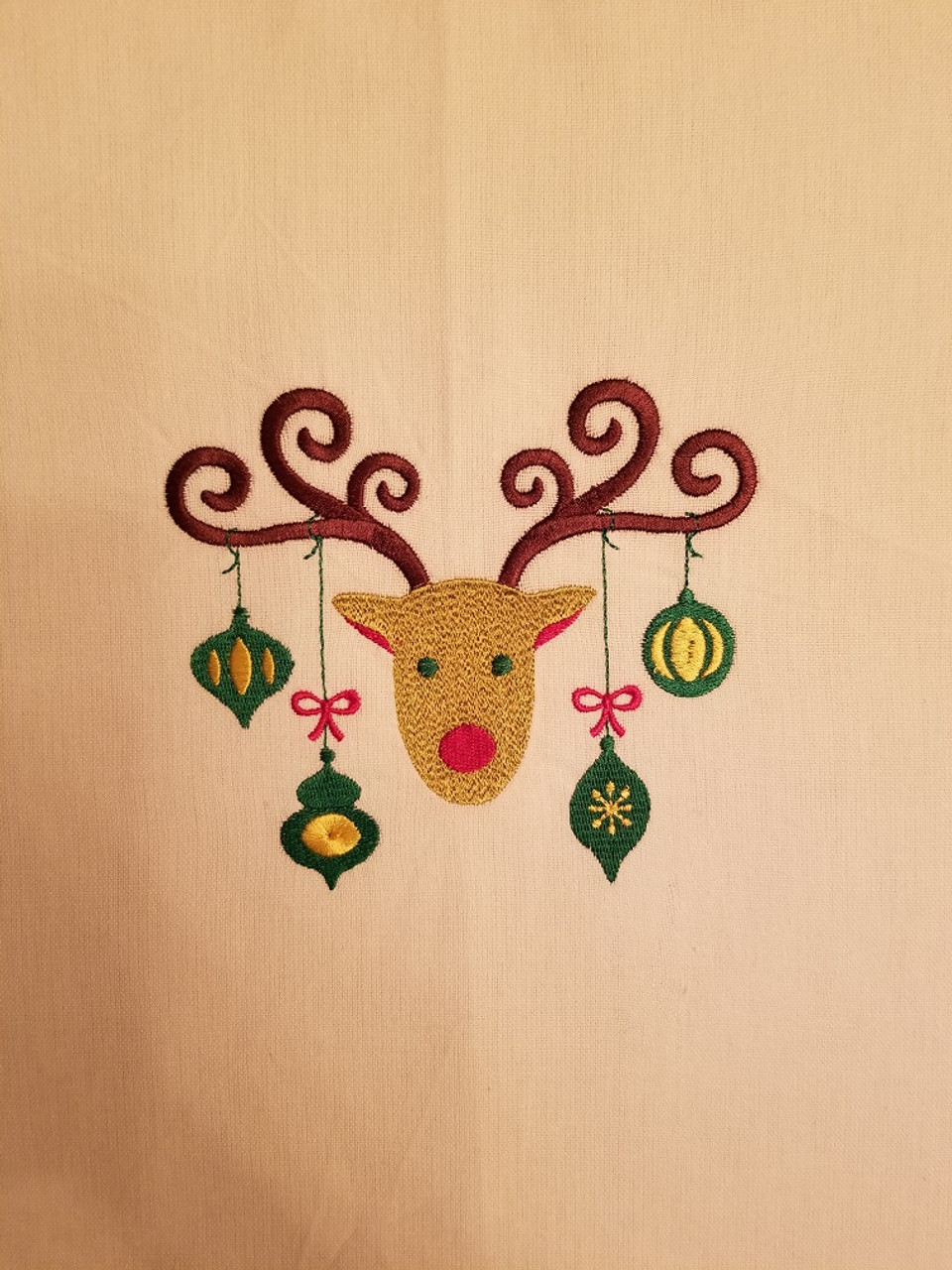 """Ornament Reindeer 1 - Kitchen Towel - 20"""" x 28"""" Embroidery on a white towel. 100% Cotton with loop, for optional hanging. Machine washable in cool water and tumble dry at low temperature. Minimal shrinkage. Size: 20"""" x 28"""""""