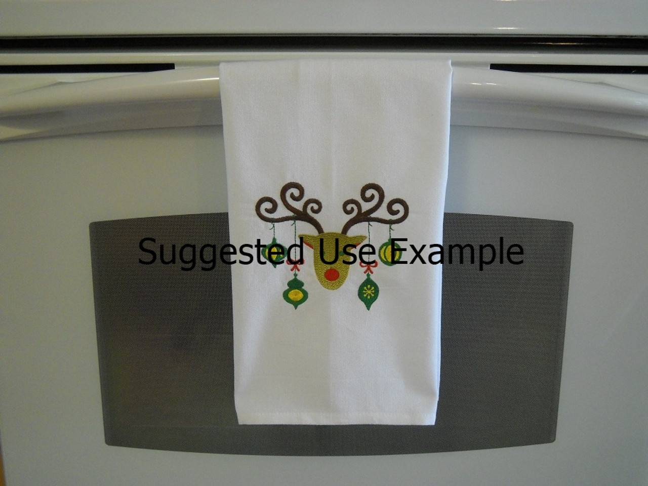"Frappe - Kitchen Towel - 20"" x 28"" Embroidery on a wheat colored towel. 100% Cotton with loop, for optional hanging. Machine washable in cool water and tumble dry at low temperature. Minimal shrinkage. Size: 20"" x 28"""