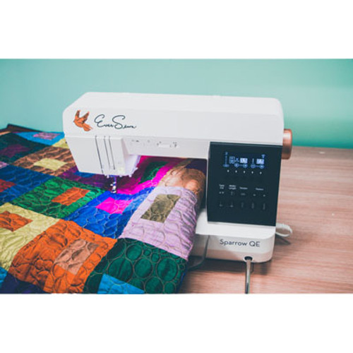 EVERSEWN Sparrow QE - The EverSewn Sparrow QE is a great sewing and quilting machine. The impeccable stitch quality, modern design and unique sewing features makes it the perfect quilting and sewing machine! It offers everything a creative sewist could need at a very attractive price / performance ratio. Key Features: The Sparrow QE has an 8 inch sewing throat that can easily handle larger quilts! The machine comes equipped with a knee-lifter, thread cutter and additional straight stitch plate. With over 70 stitch patterns, a very intuitive control panel and a flawless stitch quality - this is the perfect machine for every quilter! With over 850 RPM sewing speed, approximately 16lb., a 7mm stitch width and all other EverSewn key features this really is a great mid-range machine.