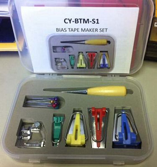 "Bias Tape Maker Set - With Case - Parts Accessories Includes 4 bias tape makers. 1 each: 1/4"", 1/2"", 3/4"", 1"". Includes an Awl, ball pins and snap on adjustable Bias Binder foot for making tape with a sewing machine. Comes in a box with foam fitted compartments for tape makers."