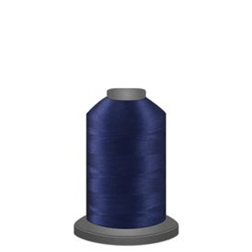 Captain Navy - Polyester - Thread - Trilobal - Glide - 40 wt This thread is strong and maintains consistent tension.  This results in less thread breakage, consistent stitch formation, resulting in fewer machine stops.  Made from colorfast polyester. Complete and uniform fill, provides a beautiful look, as if the thread melts into the fabric. Glide runs virtually lint free through your machine's tensioners and needle. Mini Spool - 40 wt - 1100 yds King Spool - 40 wt - 5500 yds Available in 269 colors.