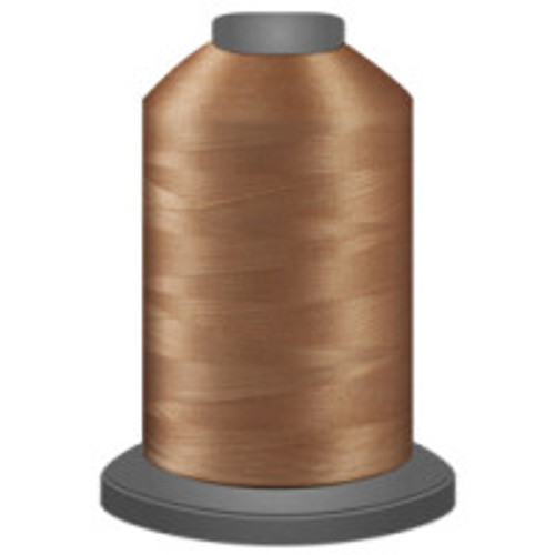 Apricot Blush - Polyester - Thread - Trilobal - Glide - 40 wt This thread is strong and maintains consistent tension.  This results in less thread breakage, consistent stitch formation, resulting in fewer machine stops.  Made from colorfast polyester. Complete and uniform fill, provides a beautiful look, as if the thread melts into the fabric. Glide runs virtually lint free through your machine's tensioners and needle. Mini Spool - 40 wt - 1100 yds King Spool - 40 wt - 5500 yds Available in 269 colors.