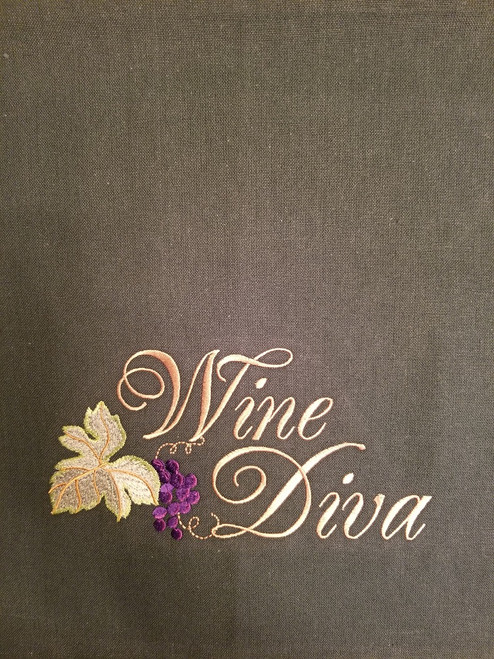 """Wine Diva 2 - Kitchen Towel - 20"""" x 28"""" Embroidery on a sage colored towel. 100% Cotton with loop, for optional hanging. Machine washable in cool water and tumble dry at low temperature. Minimal shrinkage. Size: 20"""" x 28"""""""