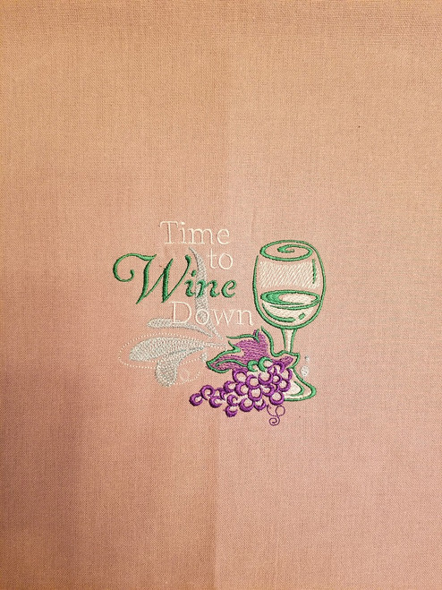 """Wine Down 2 - Kitchen Towel - 20"""" x 28"""" Embroidery on a wheat colored towel. 100% Cotton with loop, for optional hanging. Machine washable in cool water and tumble dry at low temperature. Minimal shrinkage. Size: 20"""" x 28"""""""