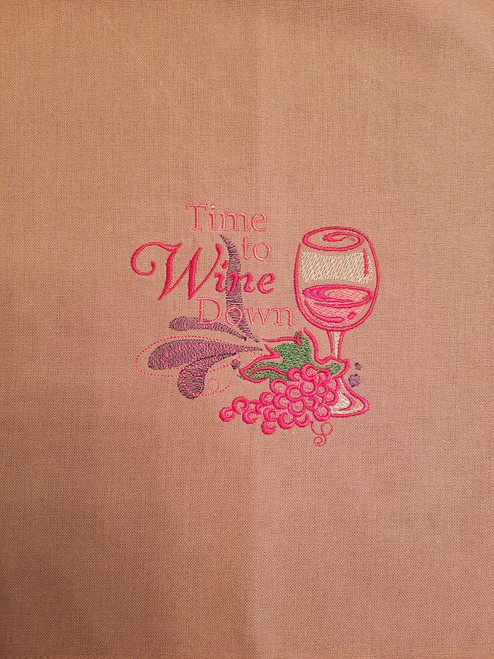 "Wine Down 1 - Kitchen Towel - 20"" x 28"" Embroidery on a wheat colored towel. 100% Cotton with loop, for optional hanging. Machine washable in cool water and tumble dry at low temperature. Minimal shrinkage. Size: 20"" x 28"""