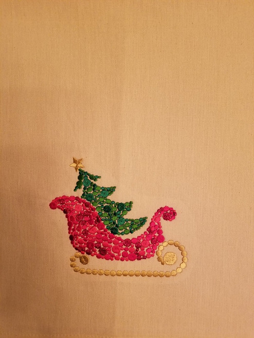 "Sleigh - Kitchen Towel - 20"" x 28"" Embroidery on a cream colored towel. 100% Cotton with loop, for optional hanging. Machine washable in cool water and tumble dry at low temperature. Minimal shrinkage. Size: 20"" x 28"""