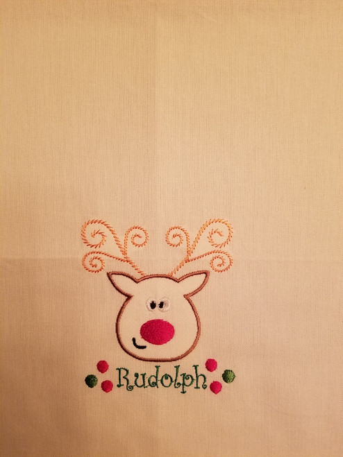 "Rudolph 2 - Kitchen Towel - 20"" x 28"" Embroidery on a white towel. 100% Cotton with loop, for optional hanging. Machine washable in cool water and tumble dry at low temperature. Minimal shrinkage. Size: 20"" x 28"""