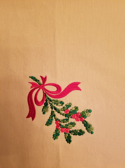 """Mistletoe - Kitchen Towel - 20"""" x 28"""" Embroidery on a cream colored towel. 100% Cotton with loop, for optional hanging. Machine washable in cool water and tumble dry at low temperature. Minimal shrinkage. Size: 20"""" x 28"""""""
