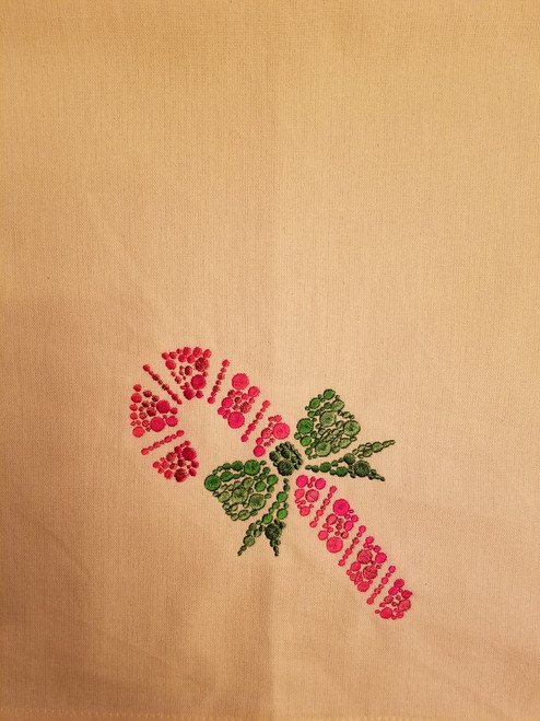 "Candy Cane Dots - Kitchen Towel - 20"" x 28"" Embroidery on a cream colored towel. 100% Cotton with loop, for optional hanging. Machine washable in cool water and tumble dry at low temperature. Minimal shrinkage. Size: 20"" x 28"""