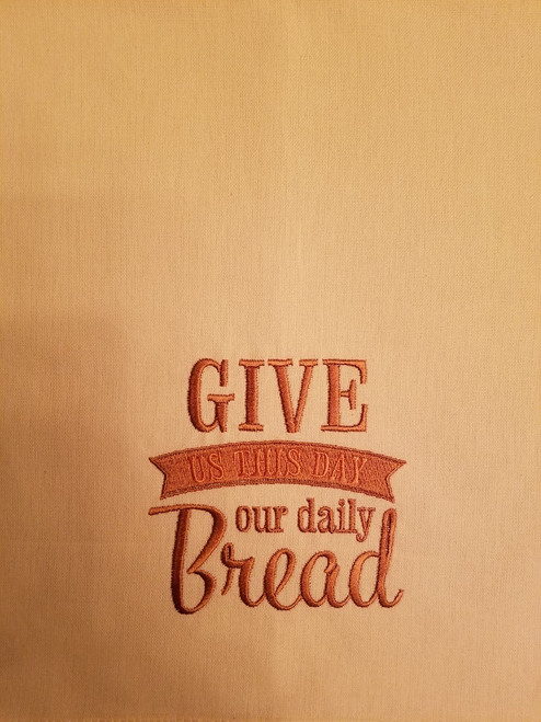 "Give Us This Day Our Daily Bread 2 - Kitchen Towel - 20"" x 28"" Embroidery on a cream colored towel. 100% Cotton with loop, for optional hanging. Machine washable in cool water and tumble dry at low temperature. Minimal shrinkage. Size: 20"" x 28"""