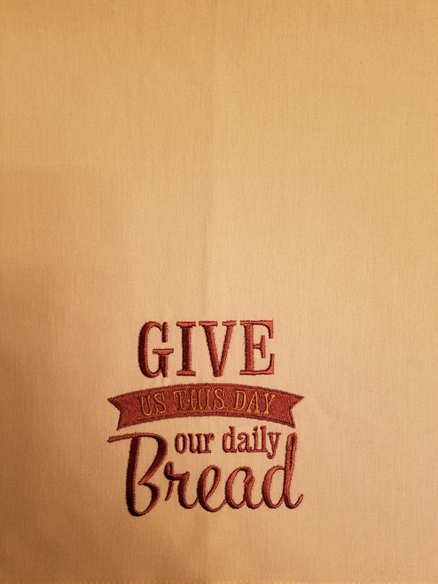 "Give Us This Day Our Daily Bread 1 - Kitchen Towel - 20"" x 28"" Embroidery on a cream colored towel. 100% Cotton with loop, for optional hanging. Machine washable in cool water and tumble dry at low temperature. Minimal shrinkage. Size: 20"" x 28"""