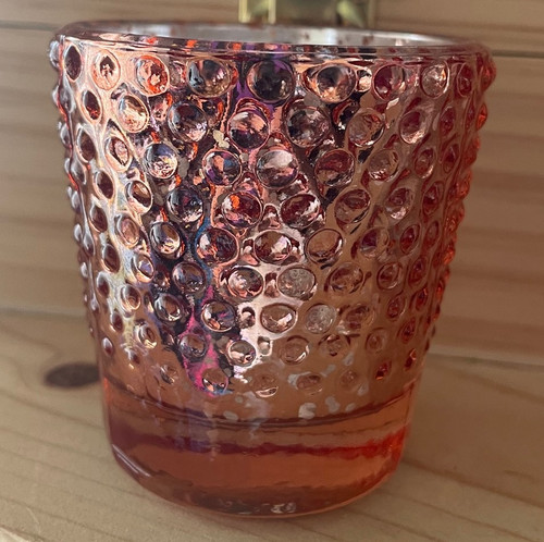 Hobnail glass has a regular pattern of raised knobs like the hobnail studs sometimes used on boot soles. It can be a pattern created by blowing a glass vessel into a mold, or it can be achieved by pressing the glass into a mold. It was very popular during Victorian times.