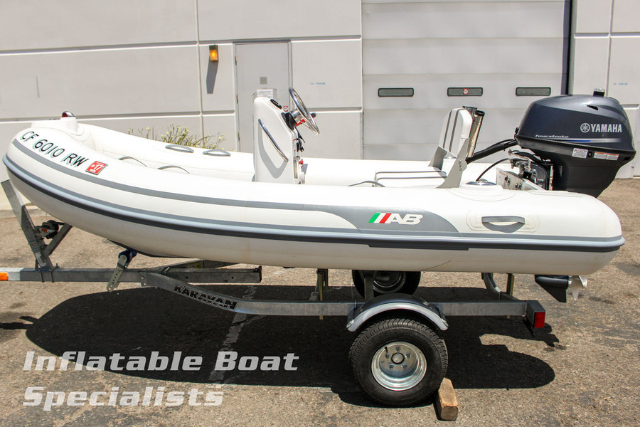 Please Note: Boat shown with optional Yamaha F25 Outboard, Rod Holders, Stainless Folding Cup Holders, Bow-Style Fuel Tank, and Trailer with Baja Launch Wheels