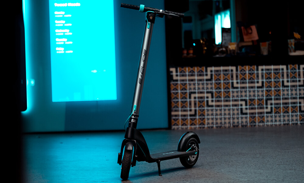 electric scooter on neon blue background
