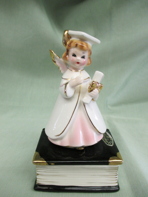 This little graduate stands atop a trinket box....