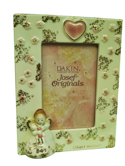 """The Newborn Photo Frame makes a great """"Grandma and Grandpa"""" gift....add the newborn doll and order the set for $34.00 (savings of $5.97)..."""