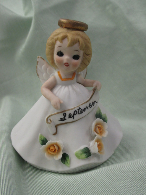 This is the George Good September Doll of the Month with all flowers in perfect condition...