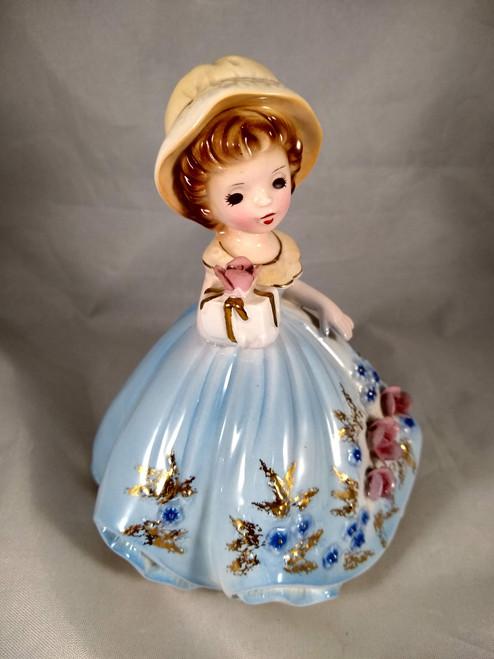 Girl in Blue Holding Gift