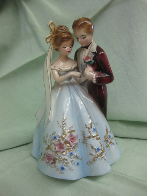 What a sweet couple....with her beautiful gown and veil...