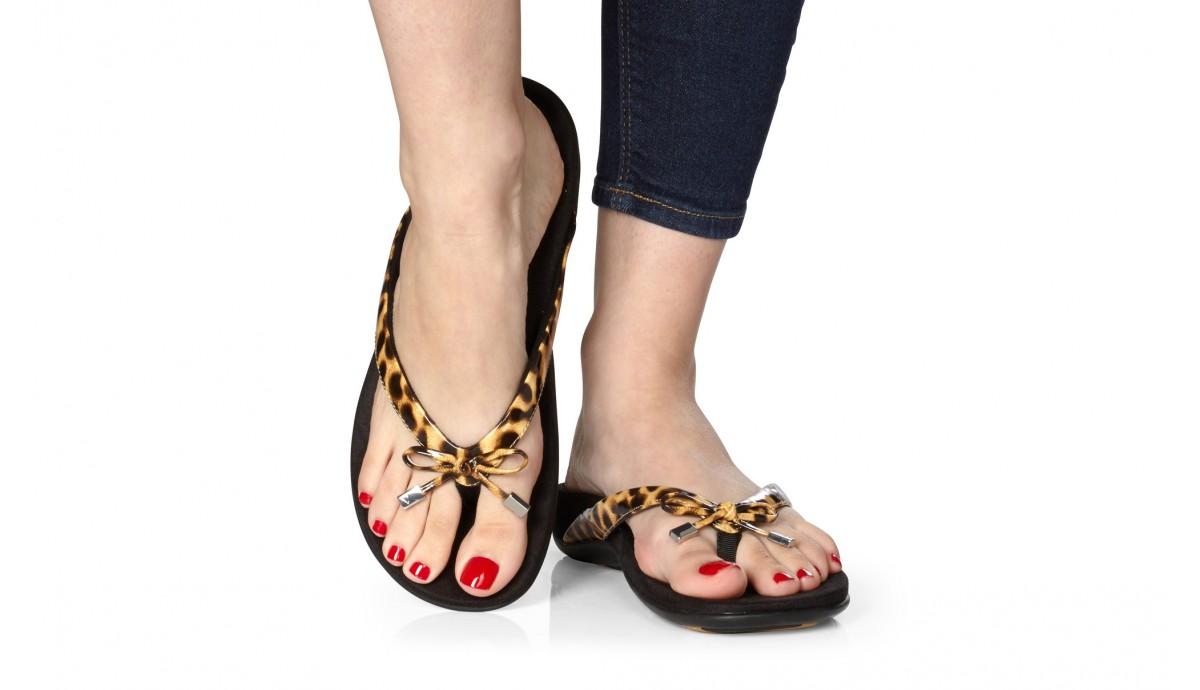 vionic-bella-2-toe-post-women-s-sandal-tan-leopard-on-foot.jpg